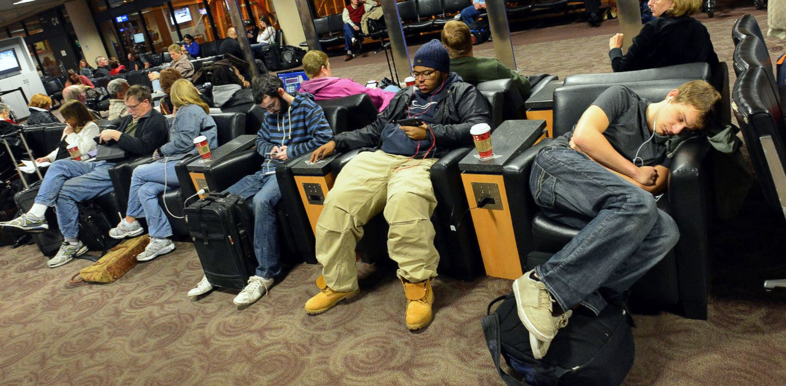 PHOTO: Travelers wait for a flight at a terminal gate at Phoenix Sky Harbor Airport in Phoenix on Nov. 26, 2013.
