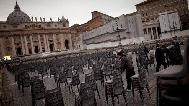 PHOTO: A worker places rows of chairs in St. Peter's Square ahead of Pope Benedict XVI last public audience, at the Vatican, Feb. 25, 2013.  Large crowds are expected to be in the next few days.
