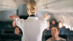 PHOTO: A flight attendant speaks to airplane passengers in an undated stock photo.