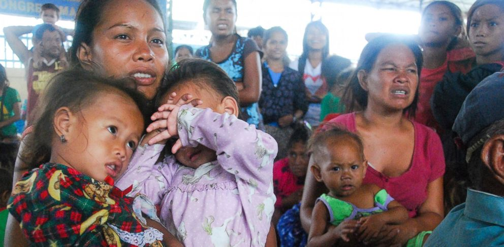 PHOTO: Families of Indigenous Filipino Badjao seek refuge inside a gymnasium turned into an evacuation center during a heavy downpour brought by Typhoon Haiyan in Cebu province, Philippines, Nov.8, 2013.