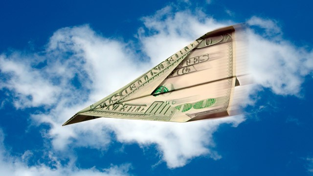 PHOTO: $100 bill paper airplane