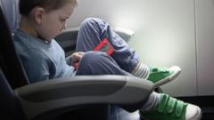 PHOTO: Bring a handheld electronic device or laptop loaded with some of your childs favorite movies or TV shows, for an easy in-flight diversion.