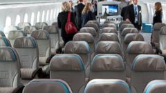 PHOTO: Attendees check out the economy class seating section of a Boeing Co. 787 Dreamliner during an event at Reagan National Airport in Arlington, Virginia, May 7, 2012.