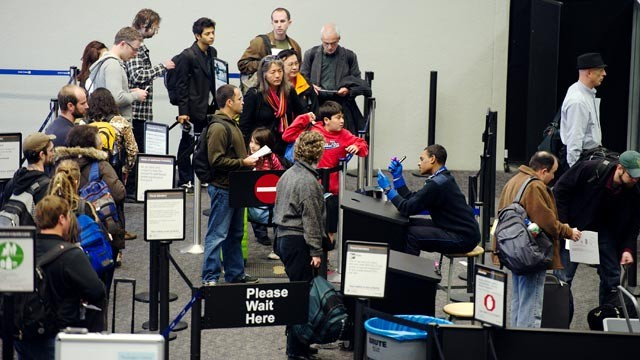 PHOTO: Travelers wait in line to go through security in the departure hall at San Francisco International Airport in San Francisco, Calif., Nov. 23, 2011.