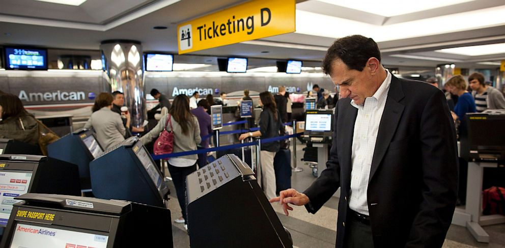 PHOTO: Traveler used self-service check in kiosk