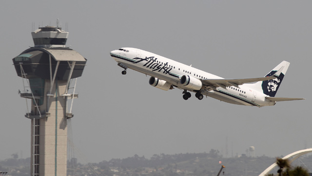 PHOTO: An Alaska Airlines jet passes the air traffic control tower at Los Angles International Airport during take-off on April 22, 2013 in Los Angeles.