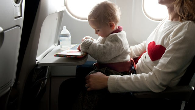 PHOTO: Babies under the age of two who are allowed to fly for free if seated on a parent's lap.