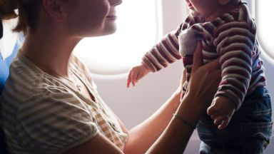 PHOTO: A Mother and her baby boy are playing on the plane in this file photo.