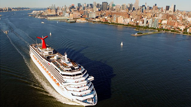 PHOTO: The Carnival Glory cruise ship passes the west side of Manhattan along the Hudson River in this aerial photograph taken over New York.