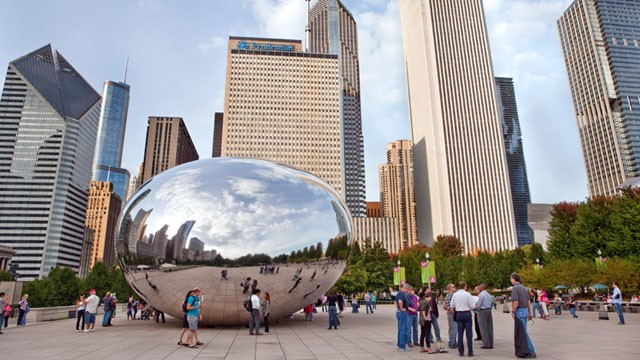 PHOTO: Tourists admire The Cloud Gate, also called the 'Bean,' sculpture in Millennium Park in Chicago.