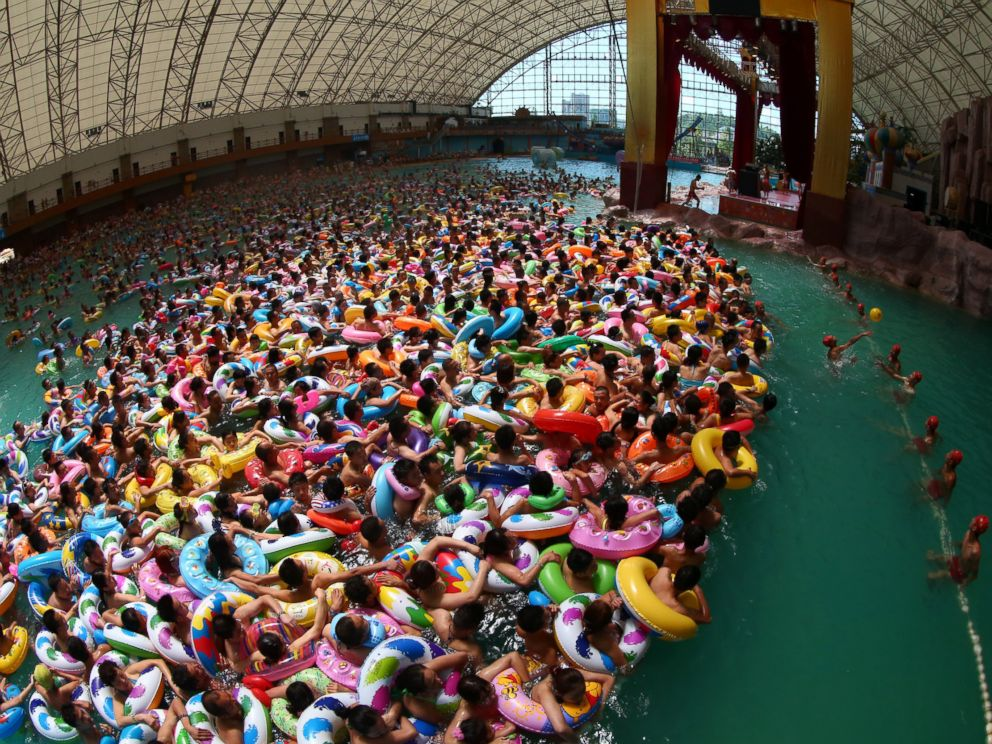 PHOTO: Thousands of people enjoy the water at the Chinese Dead Sea tourist resort as the outside temperatures reached 100 degrees on July 25, 2014 in Suining, China.