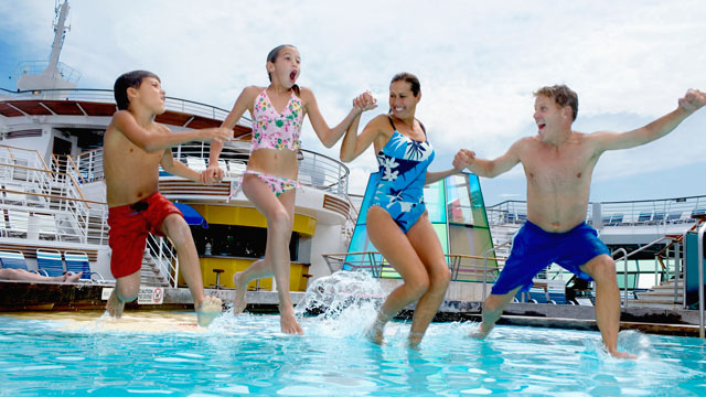 PHOTO: Parents with children jump into pool on cruise ship.