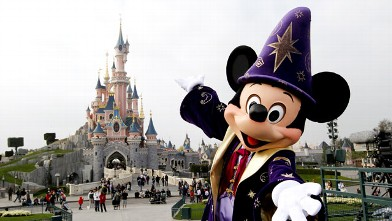 PHOTO: Disney character Mickey poses in front of the Sleeping Beauty Castle at Disneyland, March 31, 2012.
