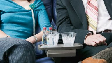 PHOTO: Should airlines put a limit on the number of drinks passengers can consume in flight?