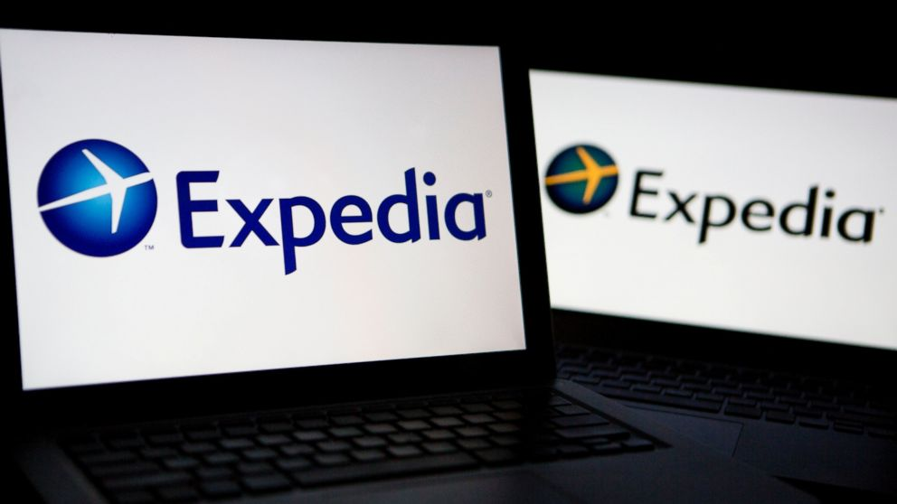 PHOTO: The Expedia Inc. logo is displayed on laptop computers arranged for a photograph in Washington, D.C., U.S., on Oct. 29, 2013.