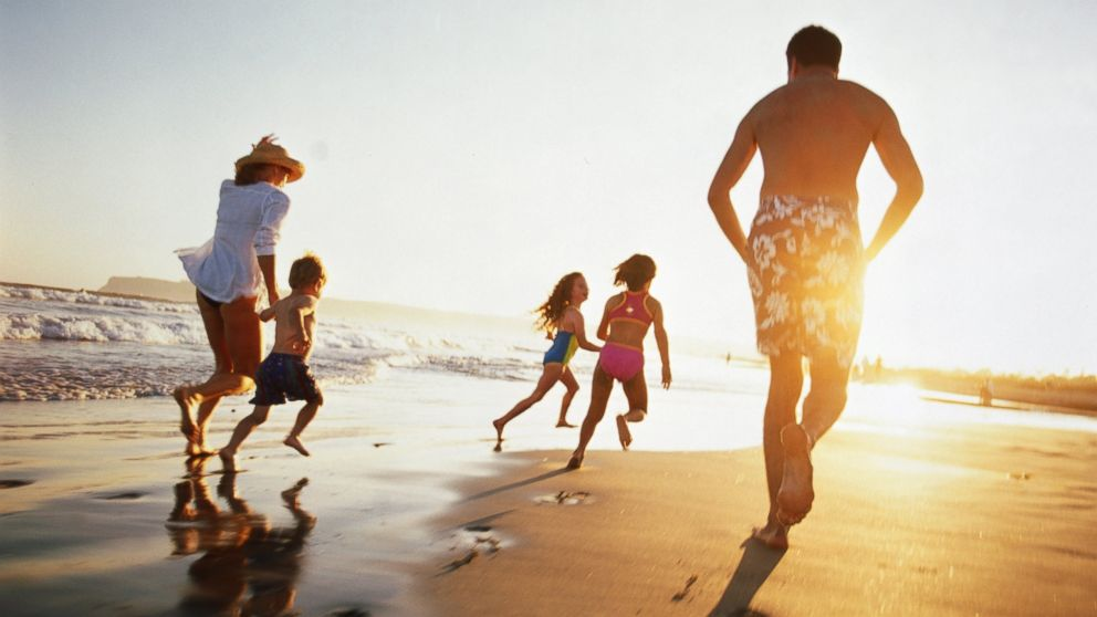 PHOTO: A family runs on the beach at sunset in this undated stock photo.