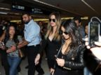 PHOTO: Khloe Kardashian and Kim Kardashian are surrounded by fans at the airport in Miami, Fla. on March 11, 2014.