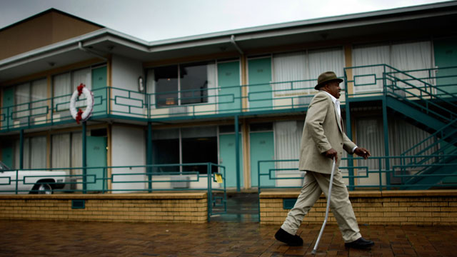 PHOTO: A Memphis resident walks past the Lorraine Hotel, and a wreath marking the location where Martin Luther King, Jr. was shot to death on the second floor in this April 3, 2008 file photo in Memphis, Tennessee.