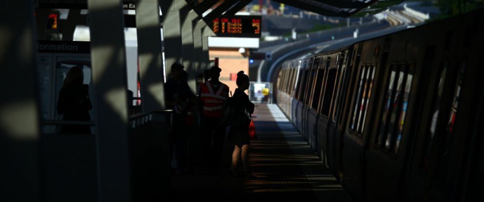 PHOTO: Commuters wait at Tysons Corner Metro station to board a Silver Line Metro train west-bound to Reston during morning commute in Tysons Corner, Va., July 28, 2014.