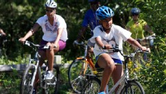 PHOTO: Sasha Obama and first lady Michelle Obama bike while vacationing on Martha's Vineyard, August 23, 2011, in West Tisbury, Mass.