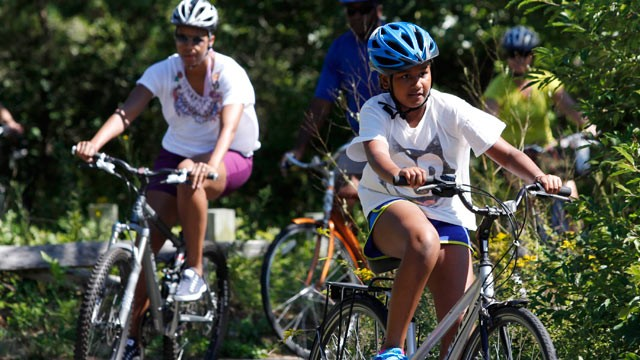 PHOTO: Sasha Obama and first lady Michelle Obama bike while vacationing on Marthas Vineyard, August 23, 2011, in West Tisbury, Mass.