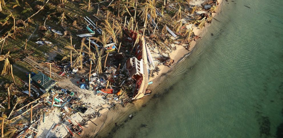 PHOTO: An aerial view of a boat washed up ashore on the demolished coastal town of Eastern Samar Island on November 14, 2013 in Leyte, Philippines.
