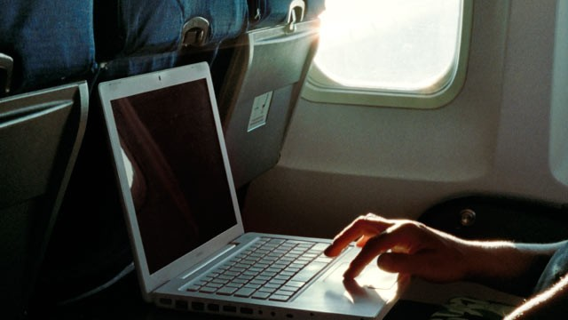 PHOTO: What do you do if the person sitting next to you on the plane is watching porn on his laptop?