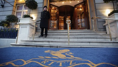PHOTO: A doorman stands at the entrance to The Ritz Hotel on February 21, 2011 in London, England.