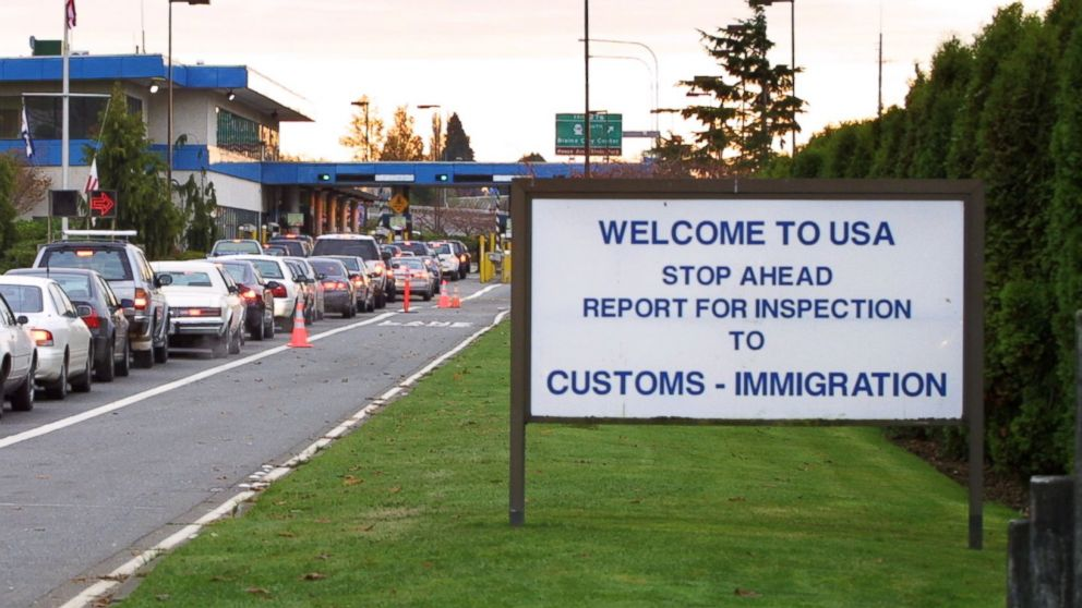 PHOTO: Vehicles line up to enter the United States at the border crossing between Blaine, Washington and White Rock, British Columbia in this Nov. 8, 2001 file photo.