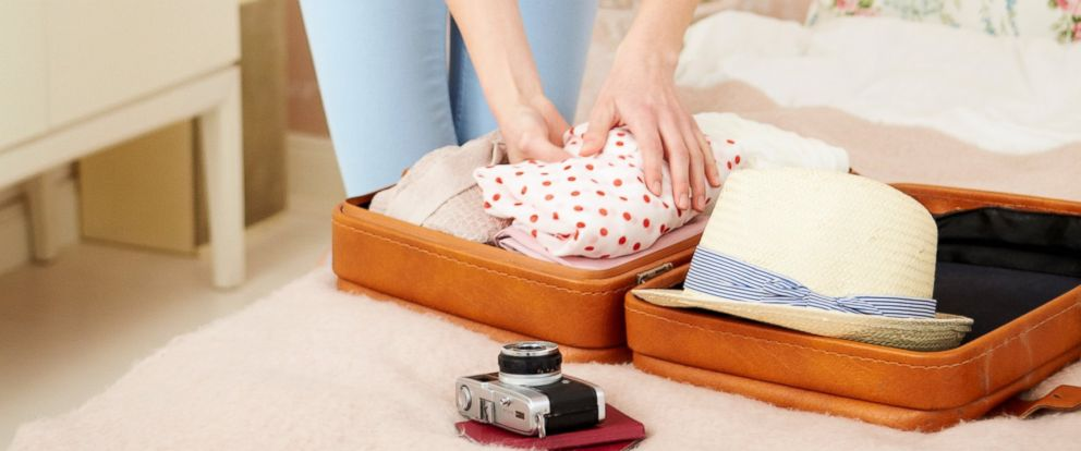 PHOTO: A women is seen in this file photo packing a suitcase.