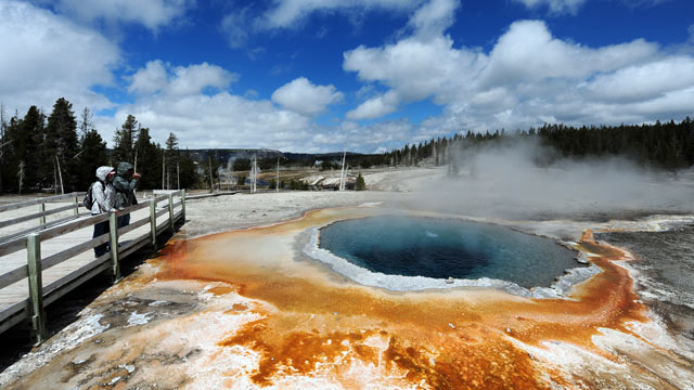 PHOTO: View of the 'Crested Pool' hot spring with it's unique colors caused by brown, orange and yellow algae-like bacteria that thrive in the cooling water, turning the vivid aqua-blue to a murkier greenish brown, in the Yellowstone National Park, Wyomin