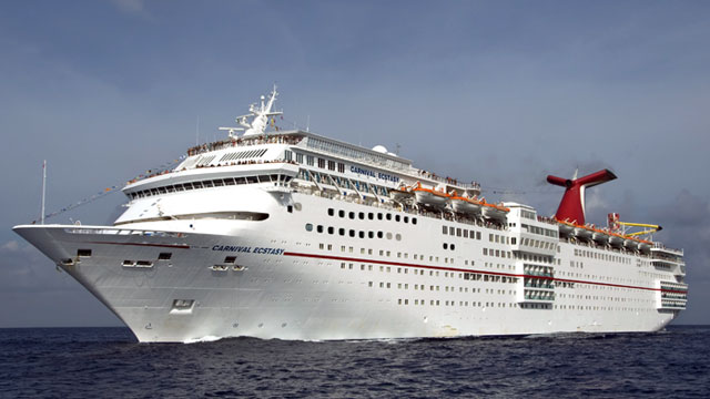 PHOTO: Carnival Cruise Lines 855-foot-long Carnival Ecstasy cruises off Cozumel,