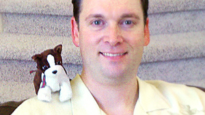 PHOTO When Scott Hardy, 34, hits the road, he always makes sure to leave room in his suitcase for his stuffed animal.