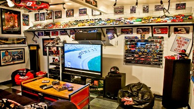 PHOTO: Robert Butterfield's NASCAR man cave. The race track along the wall is built to scale for the 1.24 scale cars of an actual NASCAR track.