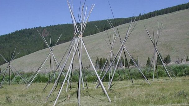 PHOTO: The 38 designated Nez Pearce park sites are spread through four states: Idaho, Washington, Montana and Oregon. Pictured here, tipi poles standing permanent vigil to commemorate the tragedy of Big Hole Battlefield.
