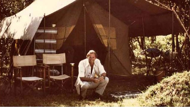 PHOTO: Geoffrey Kent in Kenya, about 1970. He said in those days, the most important thing was to find a sturdy branch at just the right height to support a canvas shower bucket.