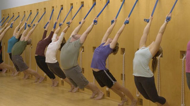 PHOTO: Rope yoga has a similar principal to aerial, but suspends people from ropes affixed to a rope wall rather than the ceiling. Different areas of the body can be supported by the ropes depending on their placement. Also, the lower ropes are placed in