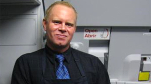 PHOTO A frustrated JetBlue flight attendant allegedly fled his plane via emergency shoot ? beer in hand ? after getting into a fight with a passenger and then cursing out the entire cabin over the loudspeaker.