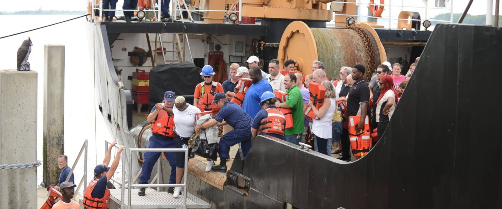 PHOTO: People rescued off a grounded casino boat by the Coast Guard step off the Coast Guard Cutter Maria Bray and onto the pier at Coast Guard Station Tybee Island, Ga., Wednesday, July 16, 2014.