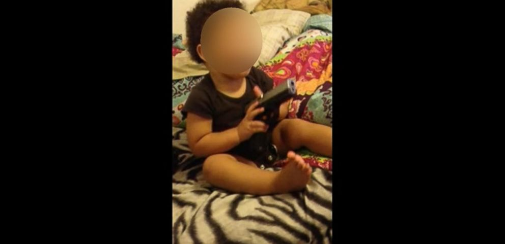VIDEO: Indiana couple faces charges after police discovered video of a 1-year-old playing with a gun.