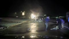 VIDEO: Two Mesquite, Texas police officers broke through a window of the burning vehicle and pulled Hector Valles to safety.