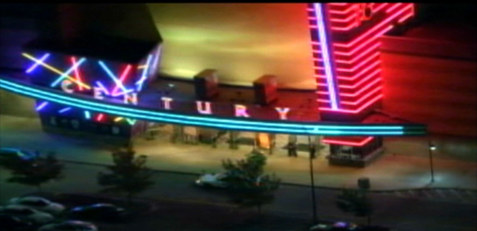 VIDEO: A frightened caller inside the Colorado theater reported the sound of fireworks shortly after the shooting.