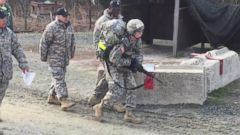 VIDEO: Capt. Sarah Cudd is shown stumbling to finish the trek in under three hours at New Jerseys Fort Dix.