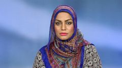 VIDEO: Tahera Ahmed claims a flight attendant told her that the unopened can of soda she requested could be used as a weapon.