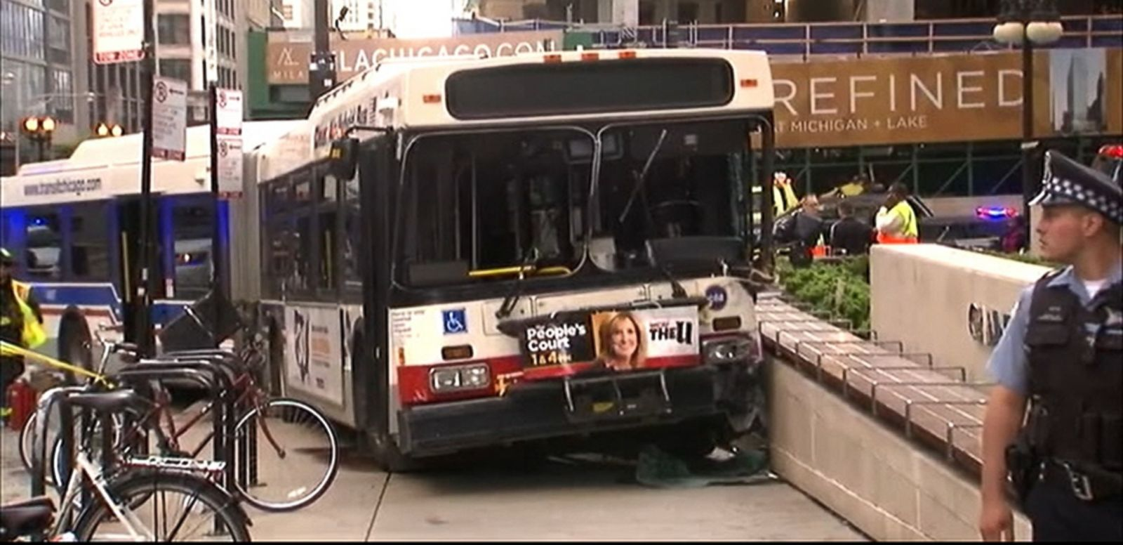 VIDEO: The Chicago Transit Authority bus was turning off a street when it collided with four cars and came to a stop on a pedestrian plaza.