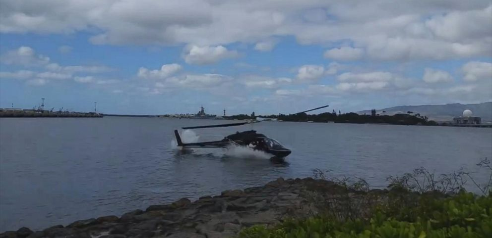VIDEO: All five personnel aboard the helicopter were able to swim to shore after they crashed near the USS Arizona Memorial in Pearl Harbor, according to the U.S. Coast Guard.