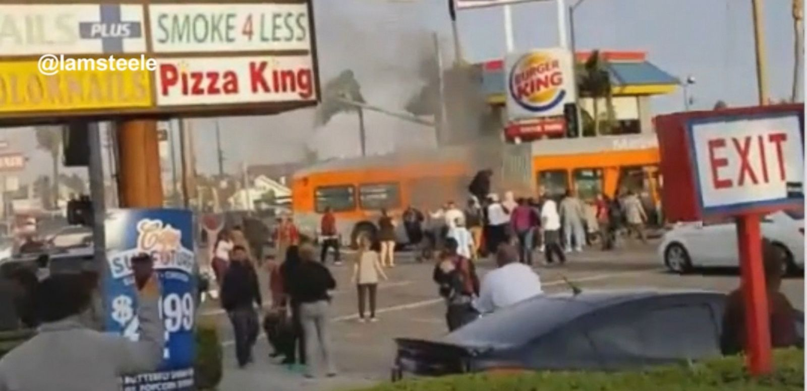 VIDEO: A man and woman were pulled from a burning Mercedes Benz that collided with a Metro bus in South Los Angeles.