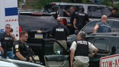 The suspected gunman is in custody, police said.