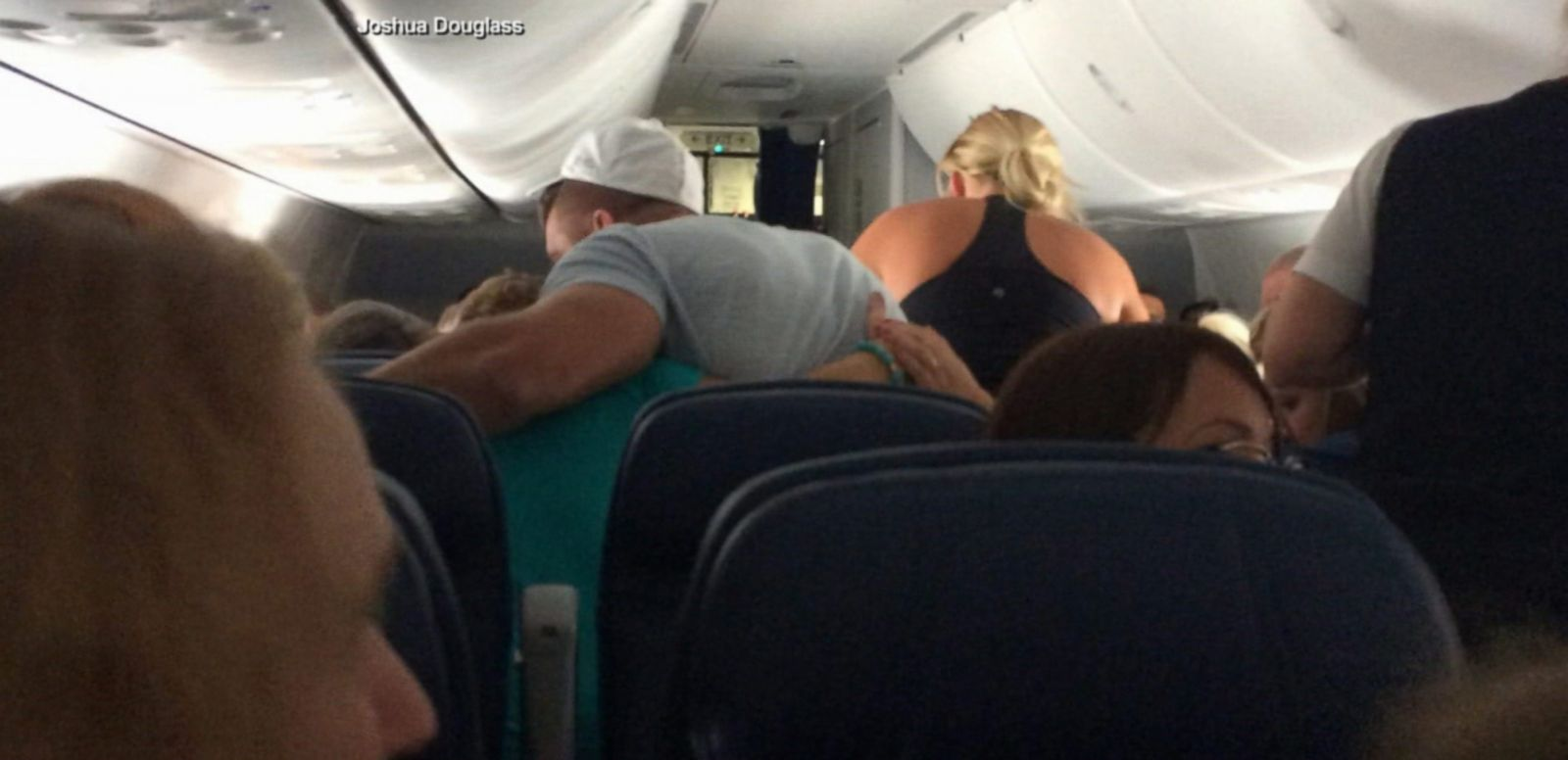 VIDEO: A midair medical emergency took a plane full of passengers by surprise when one man collapsed of an apparent heart attack.