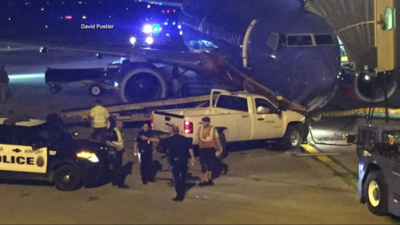 A man being chased by police after breaching a security gate at Omaha's Eppley Airfield airport Thursday night, proceeded to strip down to his boxer shorts, steal a truck on the runway and ram it into the nose of a Southwest Airlines aircraft, authorities